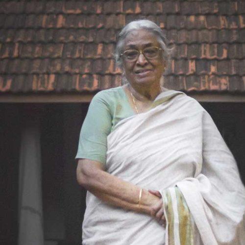 A portrait of Mrs. Meenakshi Meyyappan, proprietor of The Bangala Hotel, in the courtyard of her Karaikudi home.