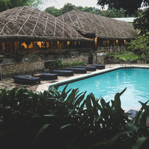Poolside at CGH Earth's Spice Village.